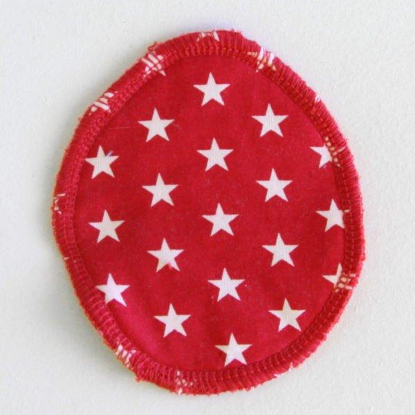 Disque à démaquiller ovale, lavable et zéro déchet, tissu rouge imprimé étoiles blanches et éponge rouge