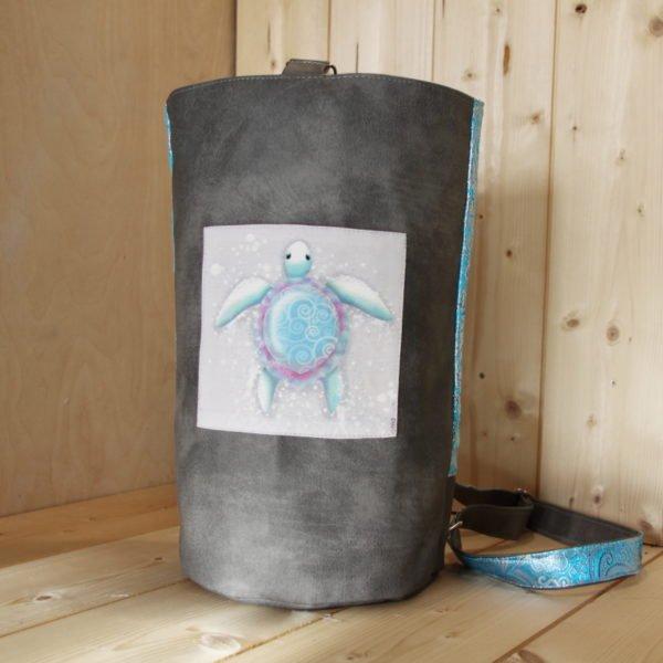 Tricotyne, sac à ouvrage pratique pour aiguilles courtes. Coloris gris et bleu avec coupon illustré Nidillus