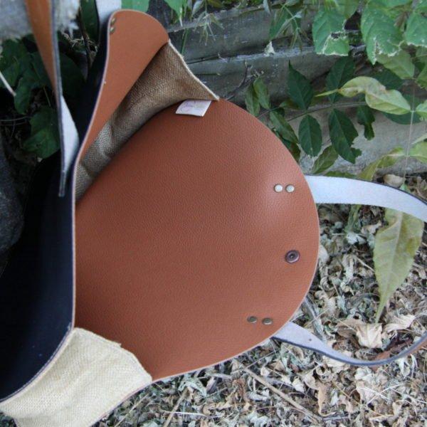 sac rond en simili cuir noir et intérieur marron