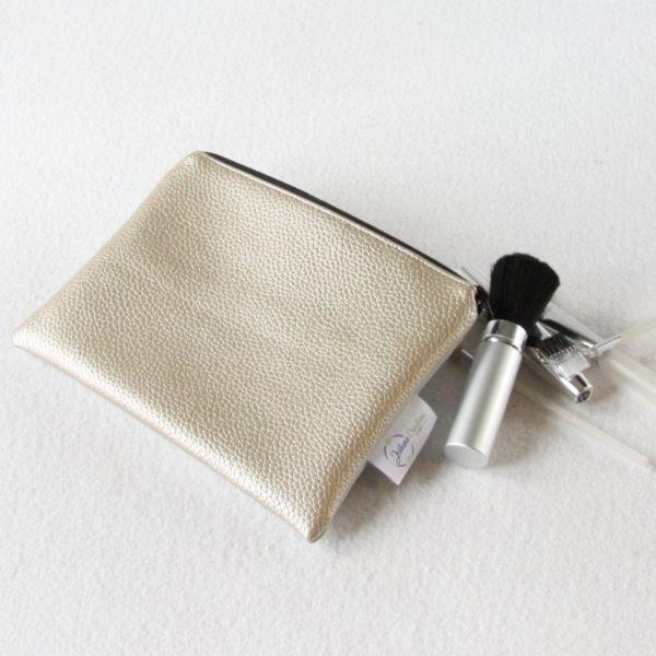 Trousse plate zippé or et argent