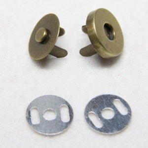 Pression magnétique en métal pour sacs